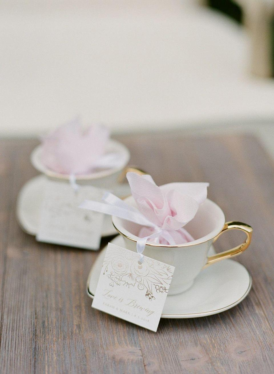 "<p>Why not host a Valentine's Day tea party? Teacups filled with blush-toned satchels sit atop heart-shaped tea saucers. </p><p><a href=""https://go.redirectingat.com?id=74968X1596630&url=https%3A%2F%2Fwww.saksfifthavenue.com%2Fralph-lauren-wilshire-tea-cup-saucer%2Fproduct%2F0400098294817%3Fsite_refer%3DCSE_GGLPLA%253AHome%253ARalph%2BLauren%26CSE_CID%3DG_Saks_PLA_US_Home%253AKitchen%2B%2526%2BDining%26gclid%3DCj0KCQiAsvTxBRDkARIsAH4W_j9n6Uz9y05PAq2PYDSK4kdSw0Mf76RuvD5125BuyHGkqSIEETnzWjgaArR4EALw_wcB%26gclsrc%3Daw.ds&sref=https%3A%2F%2Fwww.elledecor.com%2Flife-culture%2Ffun-at-home%2Fg2387%2Fvalentines-day-decor%2F"" rel=""nofollow noopener"" target=""_blank"" data-ylk=""slk:Via Style Me Pretty"" class=""link rapid-noclick-resp"">Via <em>Style Me Pretty</em></a></p><p><a class=""link rapid-noclick-resp"" href=""https://go.redirectingat.com?id=74968X1596630&url=https%3A%2F%2Fwww.saksfifthavenue.com%2Fralph-lauren-wilshire-tea-cup-saucer%2Fproduct%2F0400098294817%3Fsite_refer%3DCSE_GGLPLA%253AHome%253ARalph%2BLauren%26CSE_CID%3DG_Saks_PLA_US_Home%253AKitchen%2B%2526%2BDining%26gclid%3DCj0KCQiAsvTxBRDkARIsAH4W_j9n6Uz9y05PAq2PYDSK4kdSw0Mf76RuvD5125BuyHGkqSIEETnzWjgaArR4EALw_wcB%26gclsrc%3Daw.ds&sref=https%3A%2F%2Fwww.elledecor.com%2Flife-culture%2Ffun-at-home%2Fg2387%2Fvalentines-day-decor%2F"" rel=""nofollow noopener"" target=""_blank"" data-ylk=""slk:GET THE LOOK"">GET THE LOOK</a><em><br>Ralph Lauren Tea Cup and Saucer, Saks Fifth Avenue, <em>$65</em></em></p>"