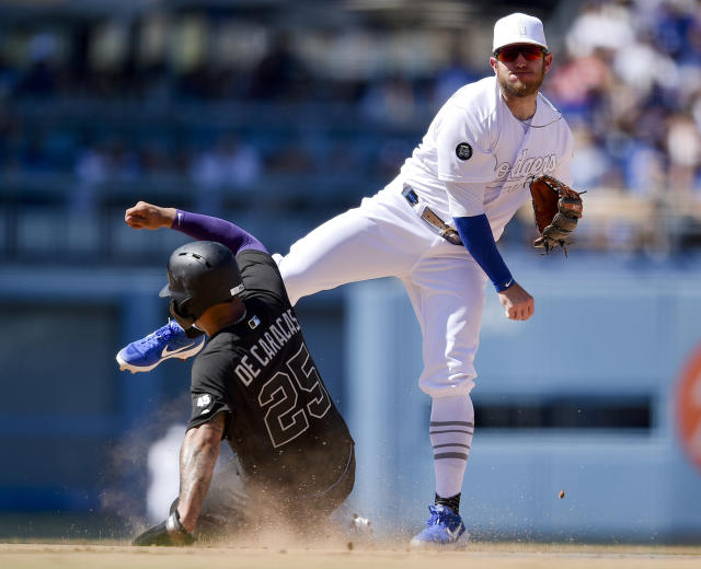 Los Angeles Dodgers second baseman Max Muncy, right, throws to first after forcing out New York Yankees Gleyber Torres during the seventh inning of a baseball game in Los Angeles, Saturday, Aug. 24, 2019. Gio Urshela was safe at first. (AP Photo/Kelvin Kuo)