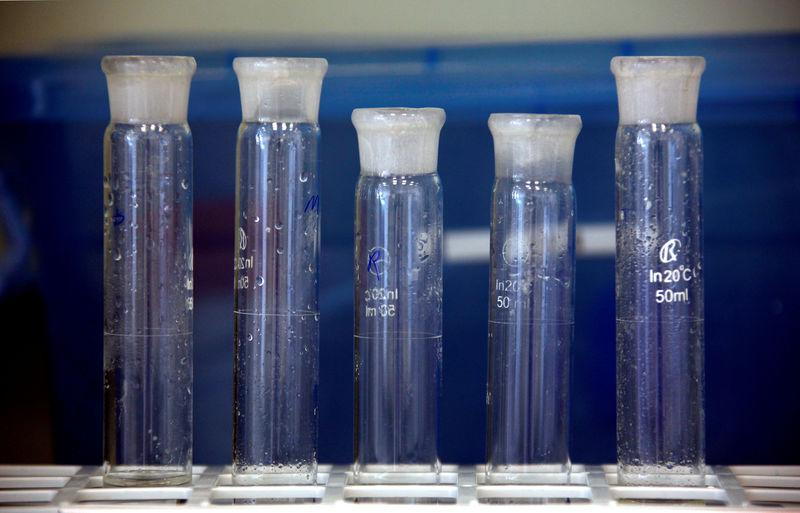 FILE PHOTO: Containers are seen in a laboratory in an enzyme factory of Danish biopharmaceutical company Novozymes in Beijing
