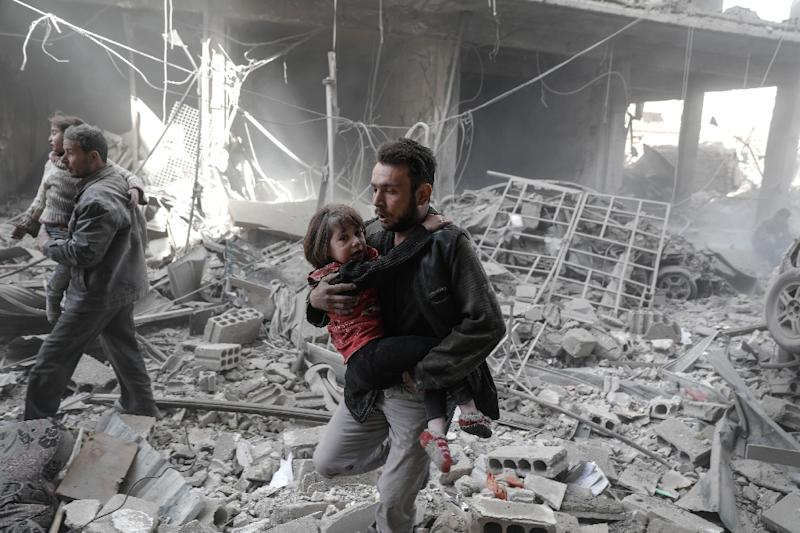"""There are three million Syrian children living in zones frequently hit by bombs and shells, with experts fearing this generation could grow up to be """"lost to trauma"""" (AFP Photo/Sameer Al-Doumy)"""