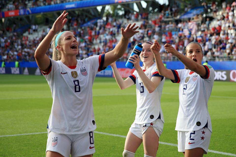(L-R) Julie Ertz, Rose Lavelle and Mallory Pugh of the USA celebrate victory after the 2019 FIFA Women's World Cup France Round Of 16 match between Spain and USA at Stade Auguste Delaune on June 24, 2019 in Reims, France. (Photo by Marc Atkins/Getty Images)