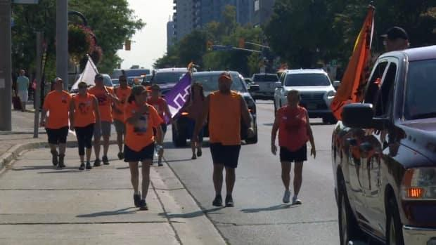 About 80 people took part in the walk from Brantford to Toronto, to remember Joe Commanda, a 13-year-old who died after fleeing from the Mohawk Institute residential school in 1968. (Mark Bochsler/CBC - image credit)