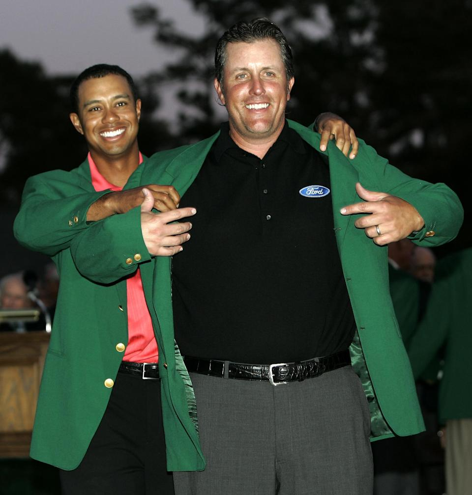 <p>Phil Mickelson, right, gets his Masters Green Jacket from last years champion Tiger Woods after winning the 2006 Masters golf tournament at the Augusta National Golf Club in Augusta, Ga., Sunday, April 9, 2006. (AP Photo/Amy Sancetta) </p>