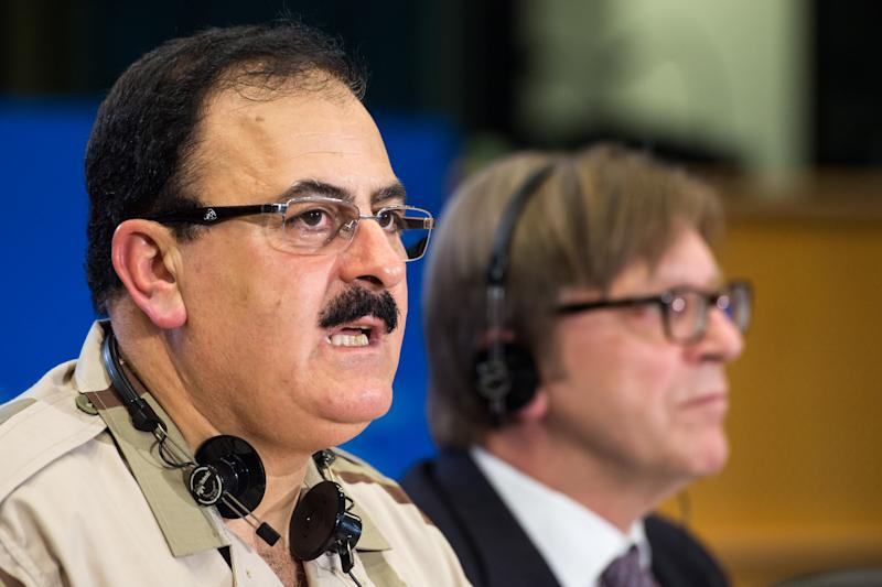 """FILE - In this Wednesday March 6, 2013 file photo, Chief of Staff of the Free Syrian Army Gen. Salim Idris addresses the media after he discussed the situation in Syria with the leader of the Group of the Alliance of Liberals and Democrats for Europe Guy Verhofstadt, right, at the European Parliament in Brussels. Idris marked the second anniversary of the start of the uprising against President Bashar Assad on Friday, March 15, 2013, by pledging to fight until the """"criminal"""" regime is gone. (AP Photo/Geert Vanden Wijngaert, File)"""