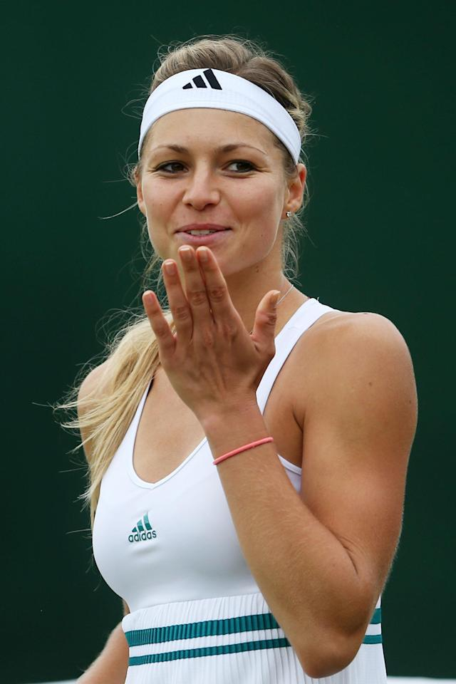 LONDON, ENGLAND - JULY 02: Maria Kirilenko of Russia celebrates match point during her Ladies' singles fourth round match against Shuai Peng of China on day seven of the Wimbledon Lawn Tennis Championships at the All England Lawn Tennis and Croquet Club on July 2, 2012 in London, England. (Photo by Julian Finney/Getty Images)
