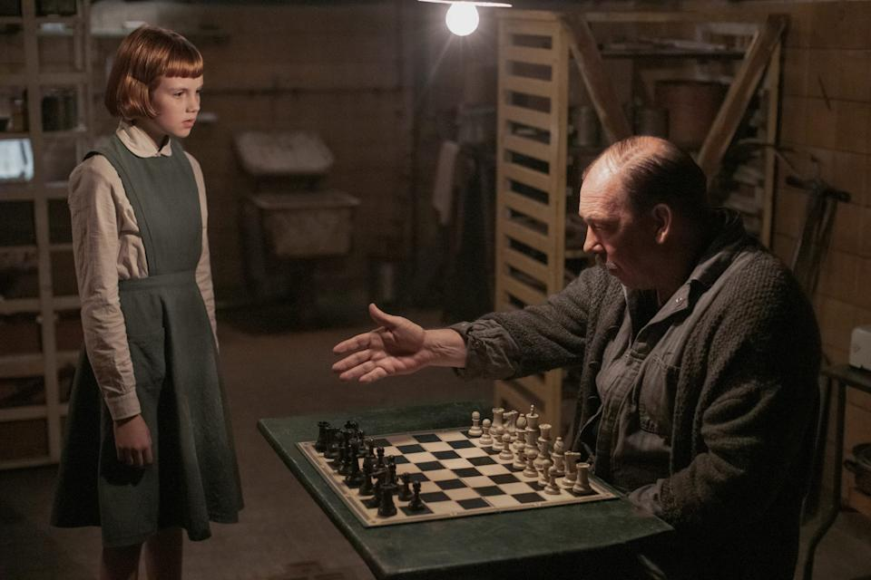 """Isla Johnston as Young Beth and Bill Camp as Mr. Shaibel in """"The Queen's Gambit."""""""