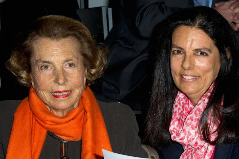 PARIS, FRANCE - JANUARY 24: Liliane Bettencourt and her daughter Francoise Bettencourt-Meyers attend the Giorgio Armani Prive Haute-Couture Spring / Summer 2012 show as part of Paris Fashion Week at Grand Palais on January 24, 2012 in Paris, France. (Photo by Pascal Le Segretain/Getty Images)