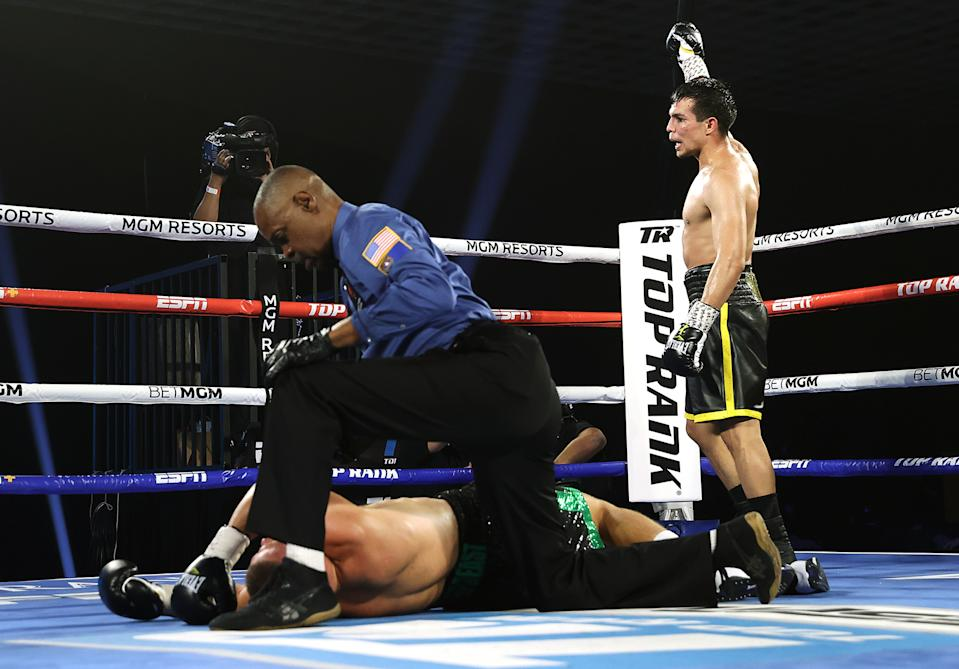 Jose Zepeda celebrates after knocking out Ivan Baranchyk on Oct. 3 at the MGM Grand Conference Center in Las Vegas. (Mikey Williams/Top Rank)