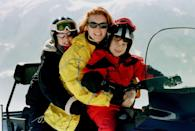 <p>Here the girls are snowmobiling with their mother on another Swiss ski vacation. </p>