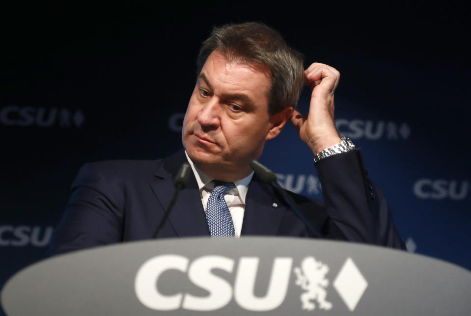 File - In this Monday, Oct. 15, 2018 file photo Bavarian governor Markus Soeder listens during a press conference at the headquarters of the Christian Social Union, CSU, in Munich. German Chancellor Angela Merkel's center-right party, the Christian Democratic Union, CDU, is choosing a new leader on the weekend Saturday Jan. 16 and Sunday Jan. 17, 2021, a decision that will help determine who succeeds Merkel at the helm of the European Union's biggest economy after a 16-year reign. (AP Photo/Matthias Schrader, file)