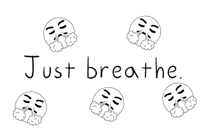 """The words """"just breathe,"""" accompanied by an emoji."""