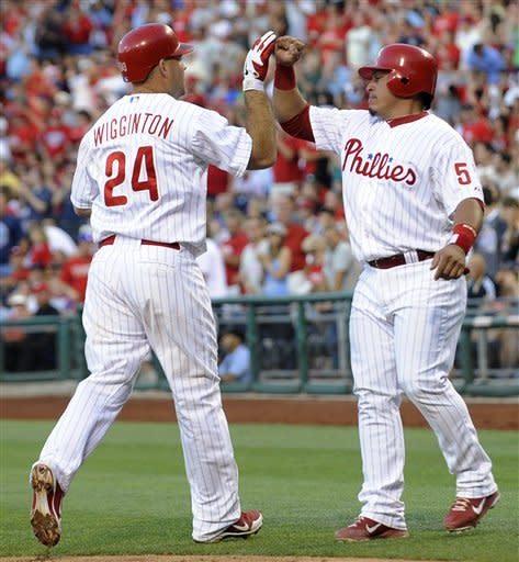 Philadelphia Phillies' Carlos Ruiz greets Ty Wiggington after he hit a two-run home run against the Pittsburgh Pirates in the third inning of a baseball game, Tuesday, June 26, 2012, in Philadelphia. (AP Photo/Michael Perez)