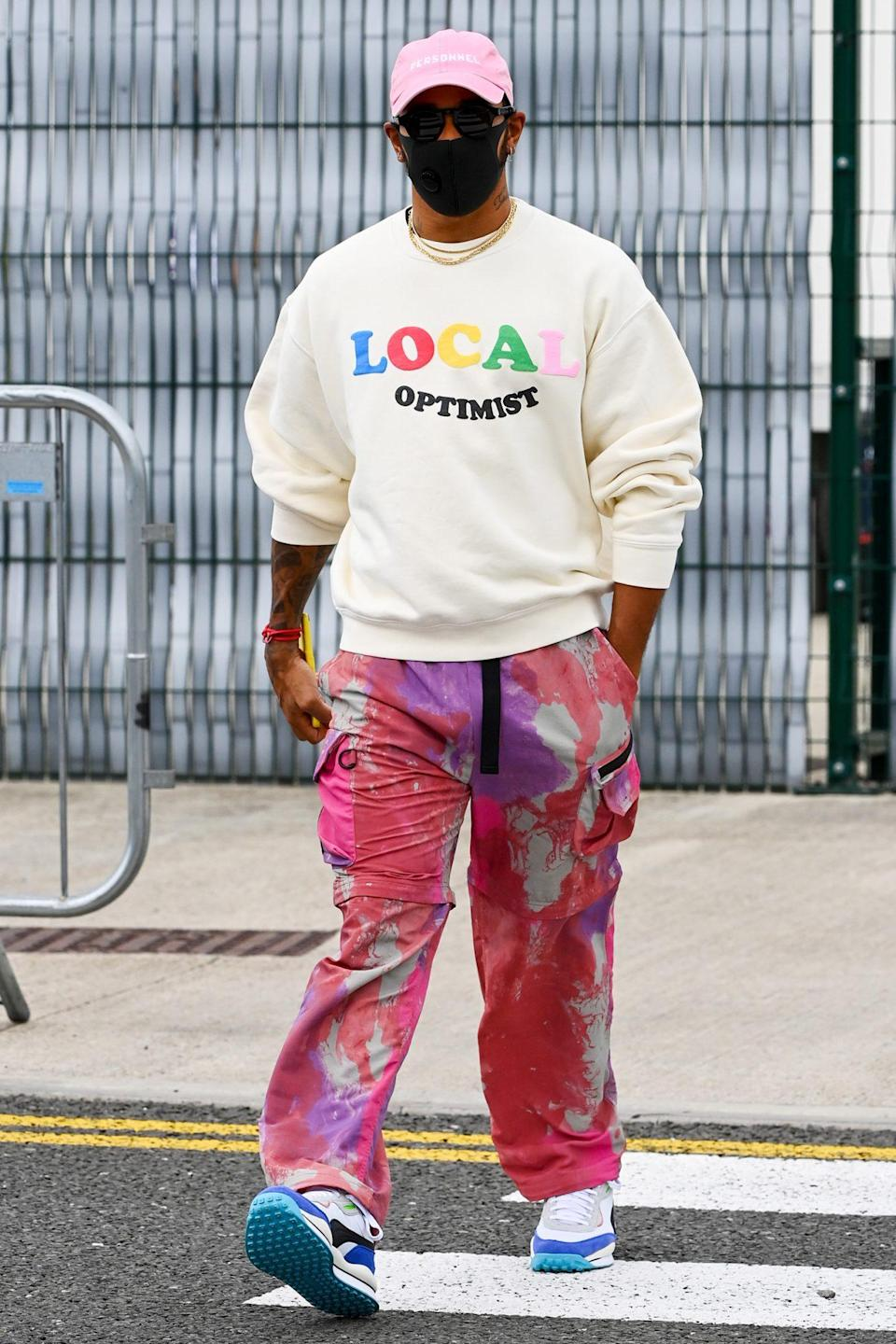 <p>Lewis Hamilton rocks a rainbow's worth of colors at the Formula One 70th Anniversary Grand Prix at Silverstone Circuit on Thursday in Silverstone, Great Britain. </p>
