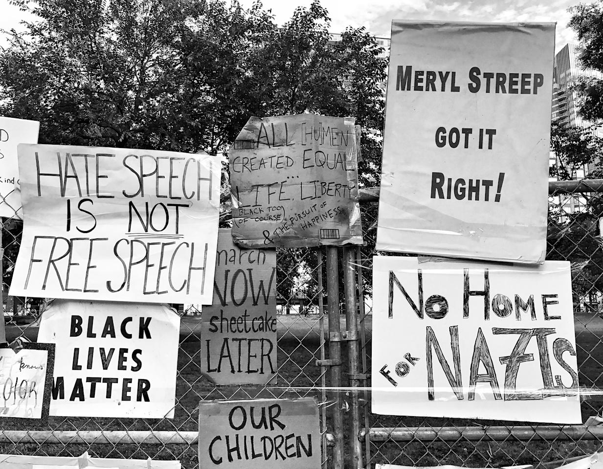 """<p>Protest signs hang on a fence inside Boston Common after a counterprotest against a """"free speech"""" rally staged by conservative activists Aug. 19 in Boston. (Photo: Holly Bailey/Yahoo News) </p>"""