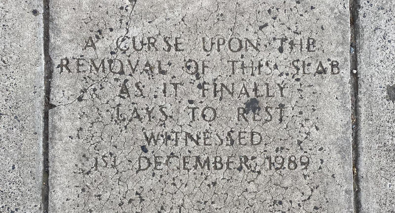 the stone reads a curse upon the removal of this slab as it finally lays to rest. Witnessed December 1, 1989
