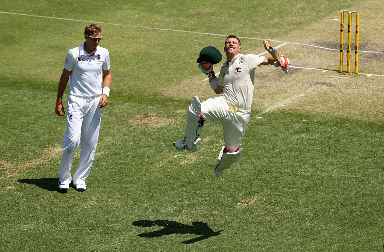 BRISBANE, AUSTRALIA - NOVEMBER 23: David Warner of Australia celebrates after reaching his century as Joe Root of England looks on during day three of the First Ashes Test match between Australia and England at The Gabba on November 23, 2013 in Brisbane, Australia.  (Photo by Ryan Pierse/Getty Images)