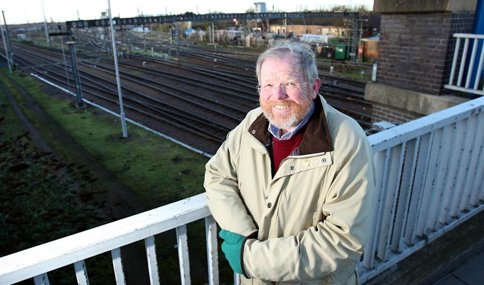 Author Bill Bryson stands alongside the railway track at Mill Road in Cambridge as he is leading a legal battle to clear litter from the railways.