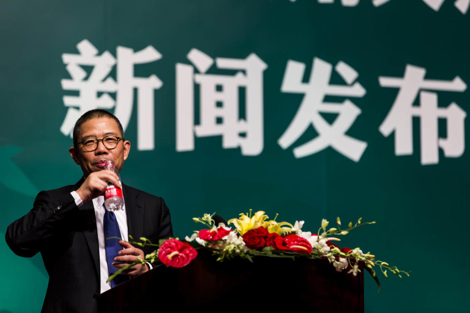 --FILE--Zhong Shanshan, Chairman of Nongfu Spring Co., Ltd., delivers a speech at a press conference in Beijing, China, May 6, 2013. Shares of Chinese bottled water giant Nongfu Spring surged more than 85\% in their debut on the Hong Kong stock market. The stock opened at 39.80 Hong Kong dollars per share ($5.14), more than 85\% higher than its initial public offering price of 21.50 Hong Kong dollars ($2.77).