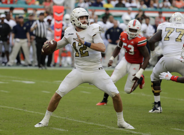 FILE - In this Sept. 22, 2018, file photo, FIU quarterback James Morgan (12) looks for a receiver during the second half of the team's NCAA college football game against Miami in Miami Gardens, Fla. FIU, going into its third season under Butch Davis, has back Morgan (26 TD passes) after a program-best nine wins last year. (AP Photo/Lynne Sladky, File)