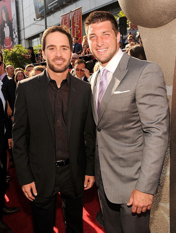 NASCAR's Jimmie Johnson poses with New York Jets quarterback Tim Tebow at the 2012 ESPY AWARDS.