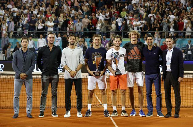 FILE PHOTO: Tennis - Adria Tour - Belgrade, Serbia - June 14, 2020 Austria's Dominic Thiem and runner-up Serbia's Filip Krajinovic pose with their trophies after the final match along with Serbia's Dusan Lajovic, Viktor Troicki, Bulgaria's Grigor Dimitov, Germany's Alexander Zverev, Serbia's Novak Djokovic and Nikola Milojevic REUTERS/Marko Djurica/File Photo