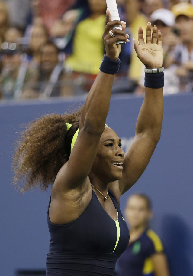 Serena Williams reacts after beating Victoria Azarenka, of Belarus, in the championship match at the 2012 US Open tennis tournament, Sunday, Sept. 9, 2012, in New York. (AP Photo/Mike Groll)