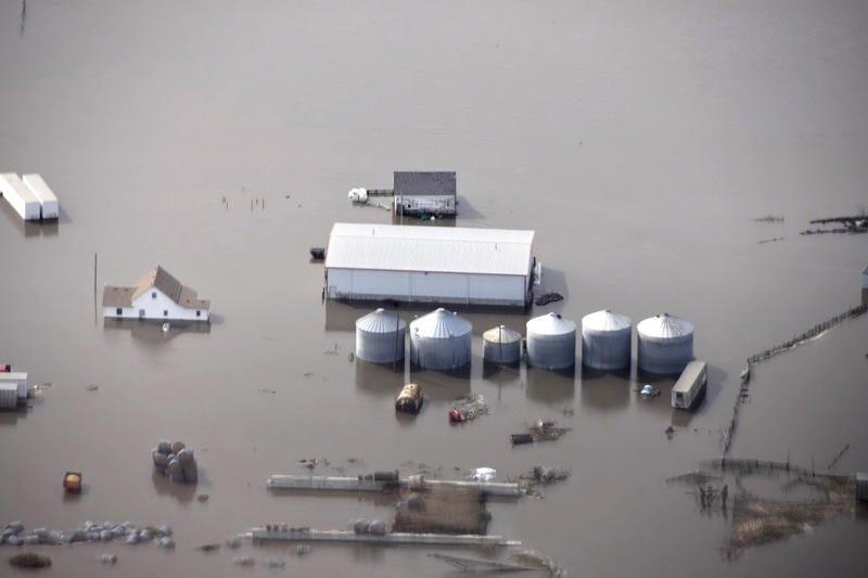 FILE - This Monday, March 18, 2019 file photo made by the South Dakota Civil Air Patrol and provided by the Iowa Department of Homeland Security and Emergency Management shows flooding along the Missouri River in rural Iowa north of Omaha, Neb. After massive flooding along the Missouri River in the spring of 2019, many want to blame the agency that manages the river's dams for making the disaster worse, but it may not be that simple. The U.S. Army Corps of Engineers says much of the water that created March's flooding came from rain and melting snow that flowed into the river downstream of all the dams, and at the same time, massive amounts of water filled the reservoirs and some had to be released. (Iowa Homeland Security and Emergency Management via AP, File )