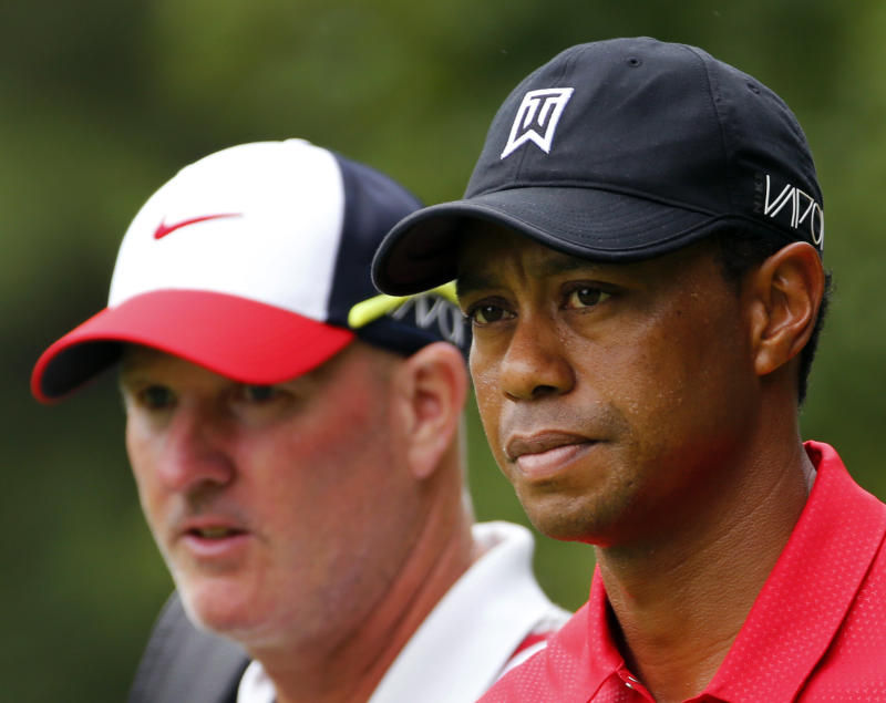 A selfie-seeking fan is the source of legal headaches for Tiger Woods and his caddie. (AP Photo/Steve Helber)