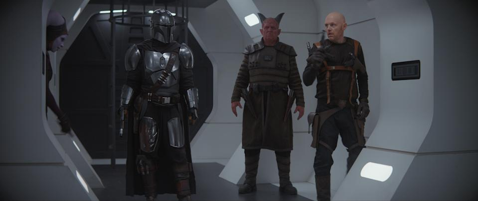 Pedro Pascal is the Mandalorian, Clancy Brown is Burg and Bill Burr is Mayfeld in THE MANDALORIAN, exclusively on Disney+