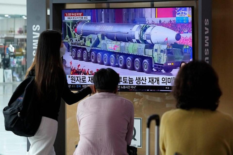 People watch a TV screen showing a file image of a North Korean missile in a military parade during a news program at the Seoul Railway Station in Seoul, South Korea, Monday (AP)