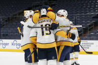 Nashville Predators' players celebrate their goal against the Columbus Blue Jackets during the first period of an NHL hockey game Saturday, Feb. 20, 2021, in Columbus, Ohio. (AP Photo/Jay LaPrete)