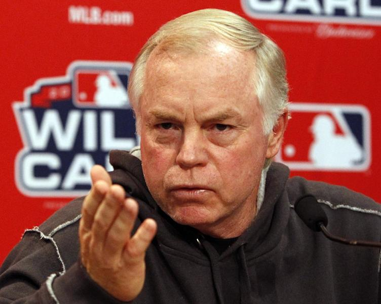 Baltimore Orioles' manager Buck Showalter takes questions from the media during a news conference at the Rangers Ballpark in Arlington, Texas, Thursday, Oct. 4, 2012. The Orioles will face the Texas Rangers in the winner-take all AL wild card baseball game on Friday. (AP Photo Richard W. Rodriguez)