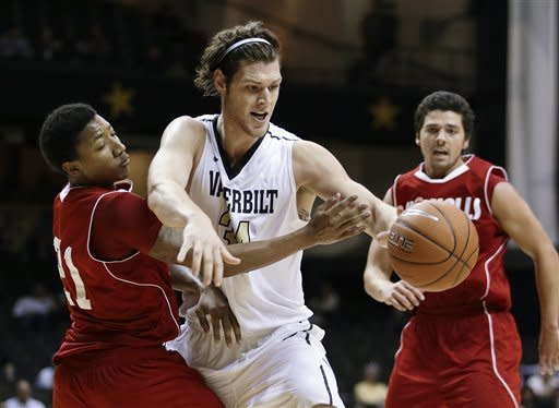 Vanderbilt forward Shelby Moats, center, tries to dribble past Nicholls State guard Shane Rillieux (21) in the second half of an NCAA college basketball game on Saturday, Nov. 10, 2012, in Nashville, Tenn. At right is Nicholls State's Pedro Maciel. Vanderbilt won 80-65. (AP Photo/Mark Humphrey)