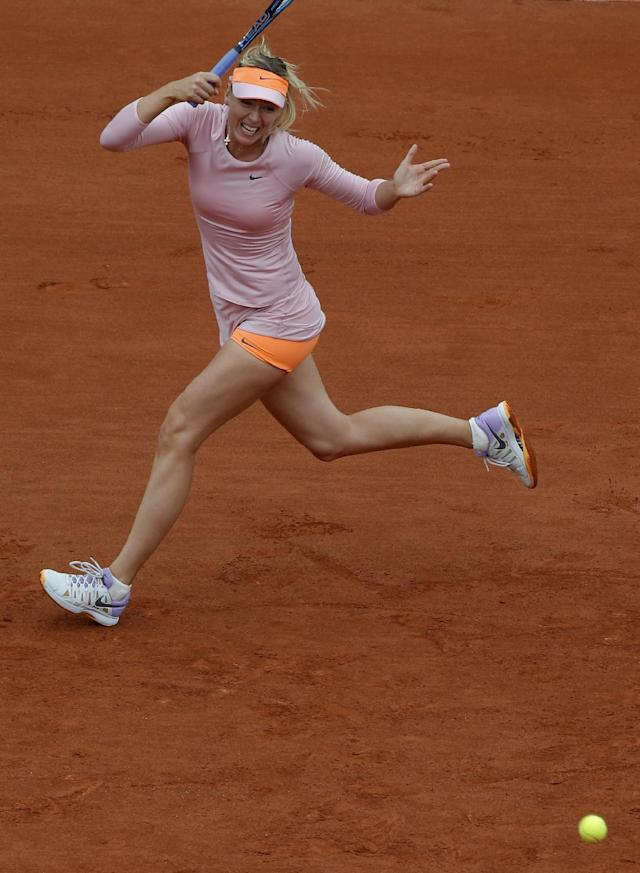 Russia's Maria Sharapova returns the ball to compatriot Ksenia Pervak during the first round match of the French Open tennis tournament at the Roland Garros stadium, in Paris, France, Monday, May 26, 2014. (AP Photo/Michel Euler)