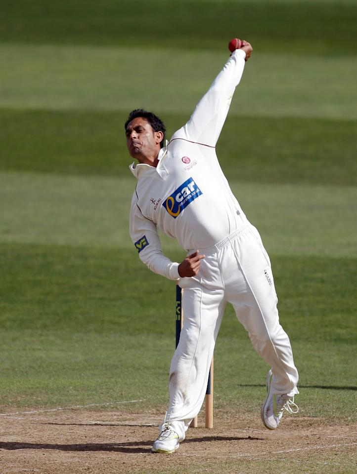 TAUNTON, ENGLAND - AUGUST 22: Abdur Rehman of Somerset bowls during day two of the LV County Championship Division One match between Somerset and Sussex on August 22, 2012 in Taunton, England.  (Photo by Harry Engels/Getty Images)