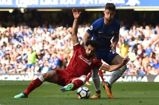 Liverpool's Egyptian forward Mohamed Salah  (L) is to have a pair of boots donated to the British Museum after his record goalscoring exploits this season