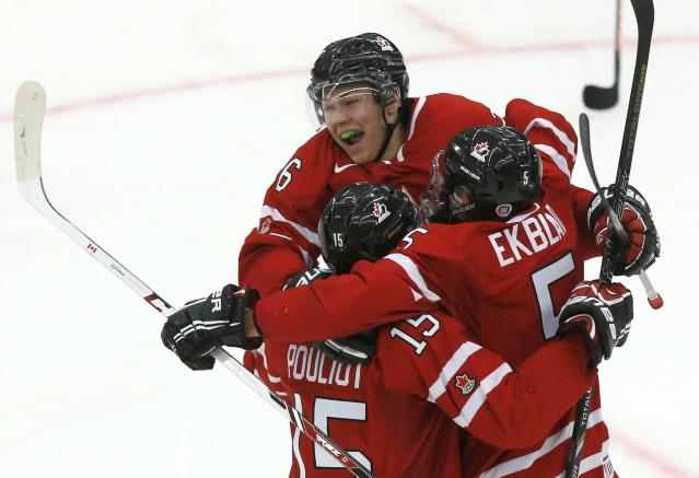 Canada's Aaron Ekblad (5) celebrates his goal against the Czech Republic with teammates Curtis Lazar and Derrick Pouliot (15) period of their IIHF World Junior Championship ice hockey game in Malmo, Sweden, December 28, 2013. REUTERS/Alexander Demianchuk (SWEDEN - Tags: SPORT ICE HOCKEY)