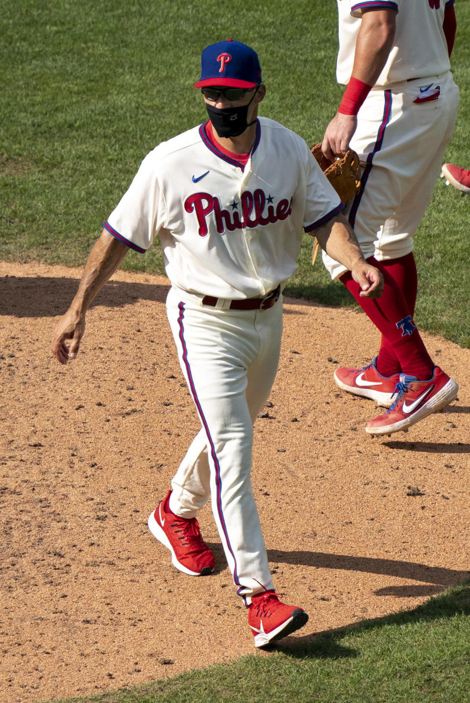 Philadelphia Phillies' manager Joe Girardi heads back to the dugout after making a pitching change during the ninth inning of a baseball game against the Miami Marlins, Sunday, July 26, 2020, in Philadelphia. (AP Photo/Chris Szagola)