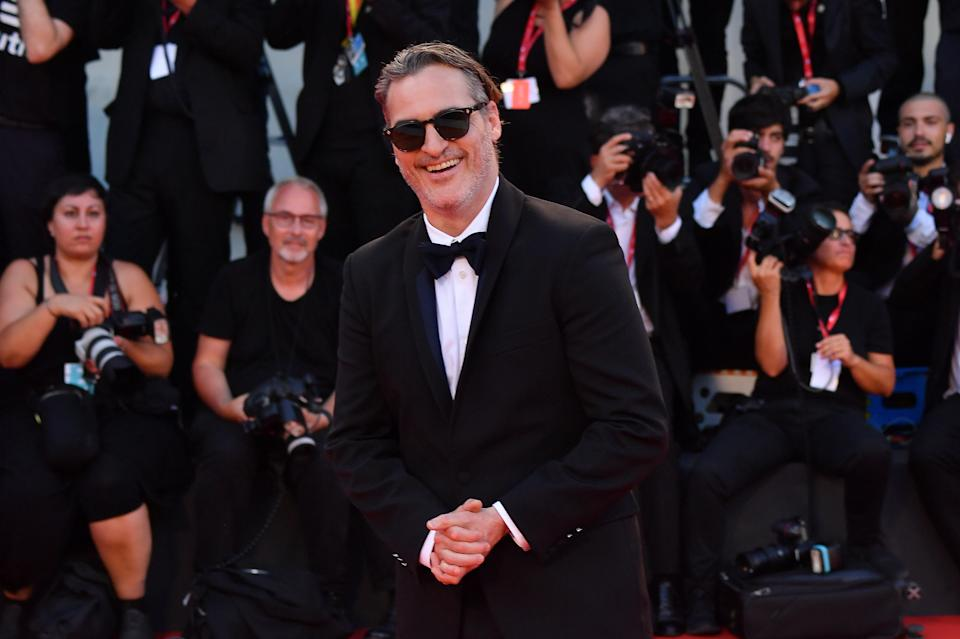 """VENICE, ITALY - AUGUST 31: Joaquin Phoenix walks the red carpet ahead of the """"Joker"""" screening during the 76th Venice Film Festival at Sala Grande on August 31, 2019 in Venice, Italy. (Photo by Stephane Cardinale - Corbis/Corbis via Getty Images)"""
