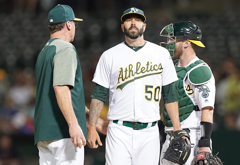 OAKLAND, CA - AUGUST 15:  Manager Bob Melvin #6 of the Oakland Athletics takes the ball from pitcher Mike Fiers #50 taking Fiers out of the game against the Houston Astros in the top of the seventh inning at Ring Central Coliseum on August 15, 2019 in Oakland, California.  (Photo by Thearon W. Henderson/Getty Images)