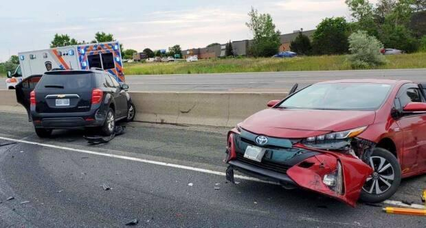 The eastbound express lanes of Highway 401 were closed at Port Union Road for an investigation into the crash. (@OPP_HSD/Twitter - image credit)
