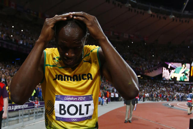 Jamaica's Usain Bolt reacts after winning the men's 100m final during the London 2012 Olympic Games at the Olympic Stadium August 5, 2012. Bolt set an Olympic record with a time of 9.63 seconds. REUTERS/Kai Pfaffenbach (BRITAIN - Tags: OLYMPICS SPORT ATHLETICS)