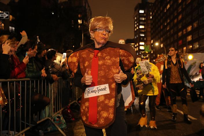 A woman wears a Trump is Toast costume in the Village Halloween Parade in New York City. (Photo: Gordon Donovan/Yahoo News)