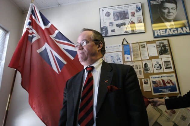 Paul Fromm poses in front of an Ontario flag in 2005. He's been linked to neo-Nazi groups in Canada and the United States.