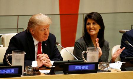FILE PHOTO: U.S. Ambassador the the U.N. Nikki Haley applauds as U.S. President Donald Trump speaks during a session on reforming the United Nations at U.N. Headquarters in New York