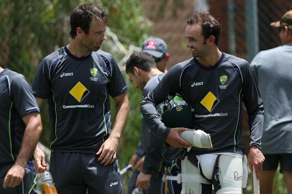BRISBANE, AUSTRALIA - NOVEMBER 06:  Rob Quiney (L) and Nathan Lyon talk during an Australian nets session at The Gabba on November 6, 2012 in Brisbane, Australia.  (Photo by Chris Hyde/Getty Images)