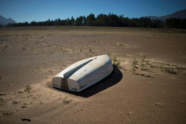 A picture taken on May 10, 2017 shows a boat lying on the sand at the Theewaterskloof Dam, which has less than 20% of it's water capacity, near Villiersdorp, about 108 km from Cape Town (AFP Photo/Rodger BOSCH)