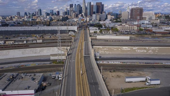 Like a scene from a disaster movie, a road in Los Angeles is almost empty as the lockdown bites
