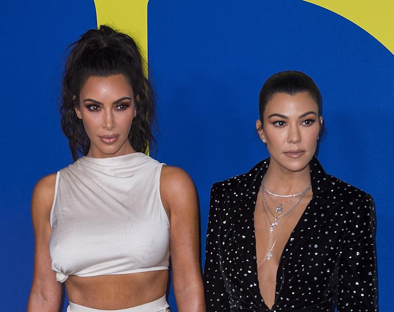 Kim Kardashian (left) and sister Kourtney Kardashian attend the annual Council of Fashion Designers of America awards showthis June in New York.