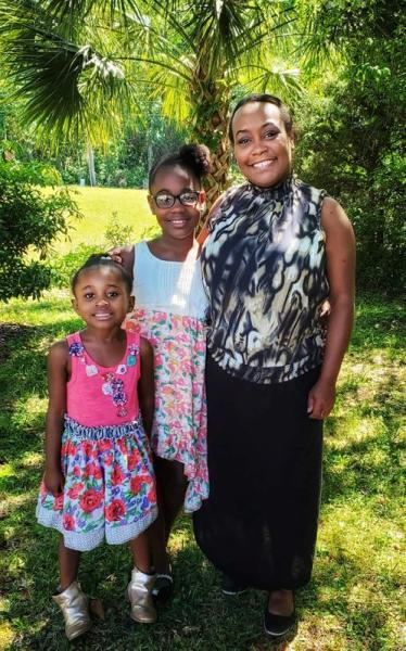 Shana Swain poses with her daughters, in Charleston, South Carolina
